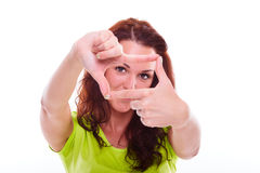 Woman is showing frame by hands Royalty Free Stock Photos