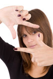 Woman showing framing hand gesture Stock Image