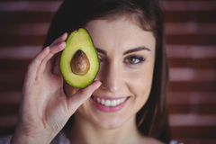 Woman showing fresh avocado Stock Photography