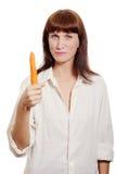 Woman showing fresh carrot Stock Photos