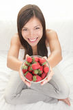 Woman showing fresh strawberries Stock Images