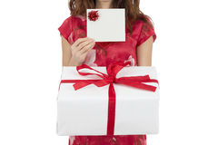 Woman showing gift card and gift box Royalty Free Stock Image