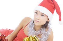 Woman showing gift wearing Santa hat. Stock Photo