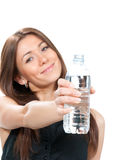 Woman showing or giving bottle of pure still drinking water Royalty Free Stock Photo