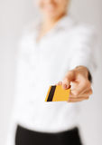 Woman showing gold credit card Stock Photo