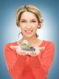 Woman showing green light bulb Stock Photos