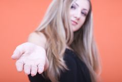 Woman showing hand Stock Images