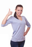 Woman showing hand with thumb up Royalty Free Stock Photography