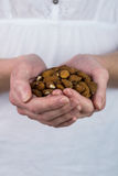 Woman showing handful of almonds Royalty Free Stock Photography