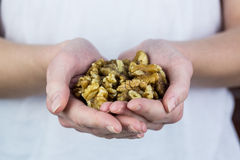 Woman showing handful of walnuts Royalty Free Stock Photo