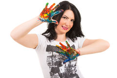 Woman showing hands in colorful paints Royalty Free Stock Photo
