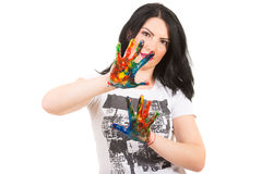Woman showing hands in paints Stock Photos