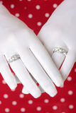 Woman showing hands wearing two diamond rings Stock Photo