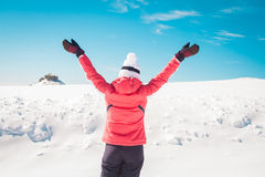 Woman showing happiness on snowy background Royalty Free Stock Photo