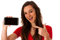 Woman showing a happy note on her smartphone Stock Photo