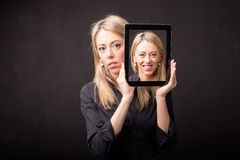 Woman showing happy portrait on tablet Stock Photography