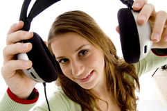 Woman showing headphone Stock Images