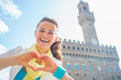 Woman showing heart gesture shaped hands, Italy Royalty Free Stock Photos