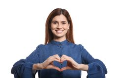Woman showing HEART gesture in sign language. On white background royalty free stock image