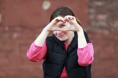 Woman showing heart Stock Photo