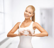 Woman showing heart shape gesture Stock Images