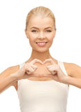 Woman showing heart shape gesture Stock Photography