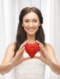 Woman showing heart shape Stock Photos