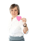 Woman showing heart shaped pink paper Royalty Free Stock Photography