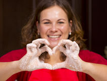 Woman showing heart sign Stock Image