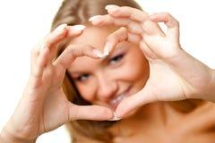 Woman showing heart symbol Stock Photo