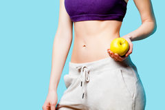 Woman showing her abs with apple after weight loss Royalty Free Stock Photos