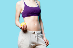 Woman showing her abs with apple after weight loss Royalty Free Stock Images