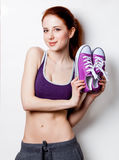 Woman showing her abs with gumshoes Royalty Free Stock Photo
