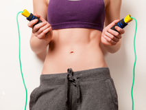 Woman showing her abs with jumping-rope Royalty Free Stock Photos