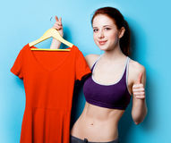 Woman showing her abs with red dress Royalty Free Stock Photography