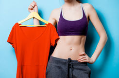 Woman showing her abs with red dress Stock Photo