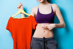 Woman showing her abs with red dress Royalty Free Stock Images
