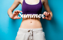 Woman showing her abs with Summer word inscription Royalty Free Stock Images