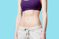 Woman showing her abs after weight loss Stock Photo