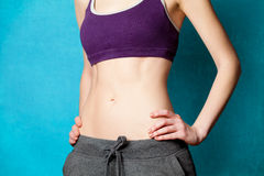 Woman showing her abs after weight loss Stock Image