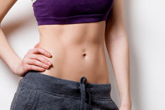 Woman showing her abs after weight loss Royalty Free Stock Photo