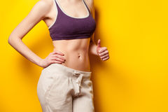 Woman showing her abs after weight loss Royalty Free Stock Photos