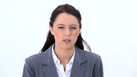 Woman showing her anger. Against a white background stock footage