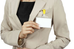 Woman showing her badge. Businesswoman showing her id badge Royalty Free Stock Image
