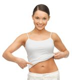 Woman showing her belly Stock Image