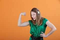 Woman Showing Her Bicep Stock Images