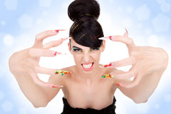 Woman showing her big fancy nails Royalty Free Stock Photos