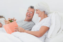Woman showing her book to her husband Royalty Free Stock Photo