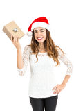 Woman showing her christmas gift Royalty Free Stock Photos