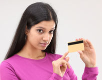 Woman showing her credit card Royalty Free Stock Image